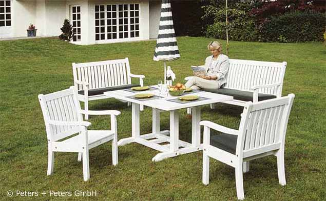 wooden garden benches and garden furniture, painted white in a,