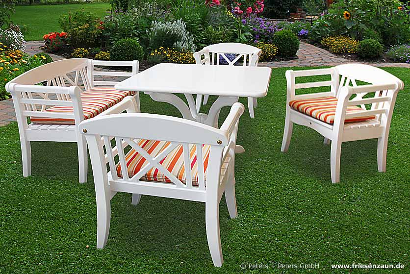 Wooden Garden Benches and Garden Furniture, painted white in a