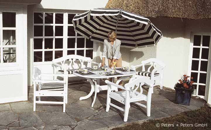 Wooden Garden Benches And Garden Furniture Painted White In A